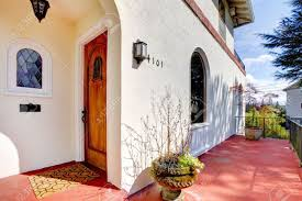 House Front Door Spanish Style White House With Red Concrete Porch And Front Door