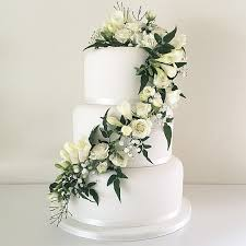 wedding cake greenery white wedding cake with trailing fresh white flowers and greenery