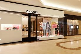chanel store dazzles with gold at south coast plaza pursuitist