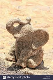 up image of an elephant garden ornament stock photo royalty