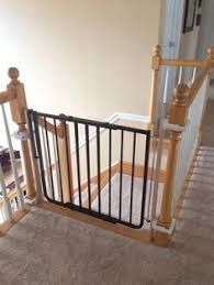 Baby Gate For Banister Stairs Baby Gate Mounted At Bottom Of Stairs Using A No Holes Banister