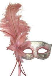 pink mardi gras mask light pink and silver venetian masquerade mask on a stick with a