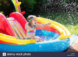 inflatable pool slide stock photos u0026 inflatable pool slide stock