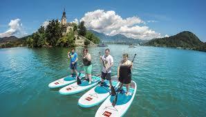 lake bled paddle boarding tour sup games on lake bled slovenia europe