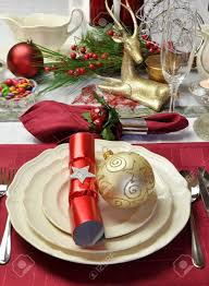 modern and stylish christmas dinner table setting including plates