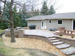 Building A Raised Patio Raised Paver Patio With Retaining Walls Stairs Deck And Seating