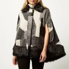 river island black patchwork faux fur trim cape in black lyst
