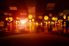 abstract background bright glowing orange lights stock photo