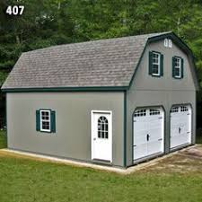 24x30 2 car garage with gambrel barn style roof built by