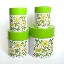 set of five vintage white canisters with by contemporaryvintage