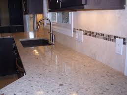 granite countertop red and white kitchen cabinets mosaic tile
