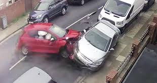 astonishing footage shows car smash into four parked vehicles