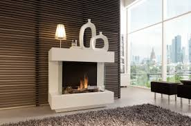 modern white concrete stand alone fireplace with glass screen on
