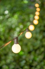 globe string lights brown wire 1 5 inch e12 bulbs 100 foot brown wire c7 strand pearl globe string