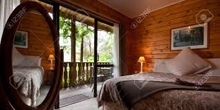 nice warm bedroom interior of mountain lodge with terrace and