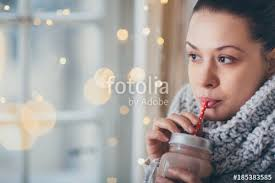hot themes for windows phone close up of woman drinking hot chocolate next to the window winter