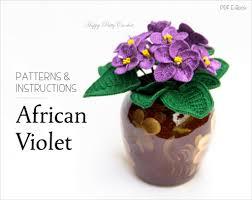 crochet african violets in dark round vase