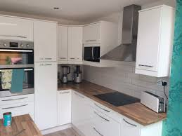 Ikea Kitchen Cabinet Construction Cream Kitchen With Grey Tiles And Wooden Worktop Google Search