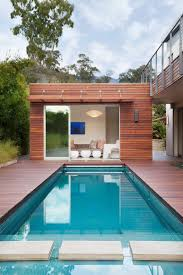 outdoors minimalist pool house with cozy sofa near modern pool