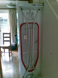 hide ironing board in pullout unit under stairs storage ideas