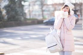 powder pink jacket silver backpack marska top styling