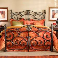 lots of old fashioned beds have fancy iron bed frames often in