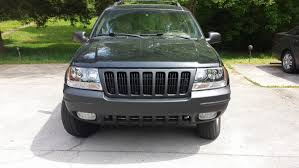 2000 gold jeep grand cherokee 2000 jeep wj new face lift bed liner and new lights jeep