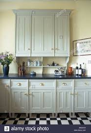 grey kitchen units with black granite worktops granite worktops high resolution stock photography and