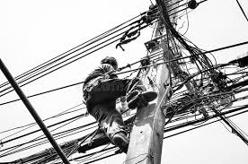 electricians repairing wire at climbing work on electric post