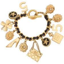 gold chain bracelet with charms images Vintage chanel iconic charm bracelet with black leather gold chain jpg