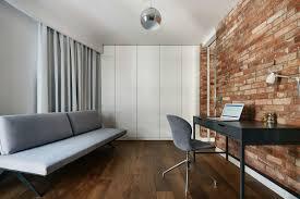 renovated krakow apartment showcases beauty of exposed brick walls