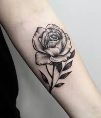 dotwork rose tattoo on left forearm