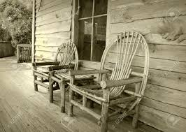 Rocking Chair Old Fashioned Old Fashioned Frontier Home With Porch And Chairs Stock Photo