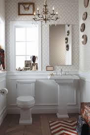 bathroom white kohler sinks under the mirror with white window