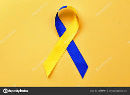 blue and yellow ribbon blue and yellow ribbon on color background stock photo
