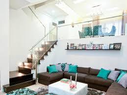 white wall stair lighting gray throw pillow beige floor shag rug