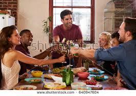 dinner host host friends making toast dinner party stock photo 640947604