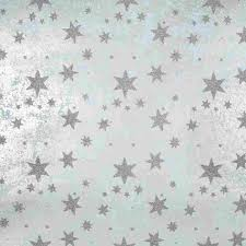silver wrapping paper silver glitter on light blue gift wrap sheet