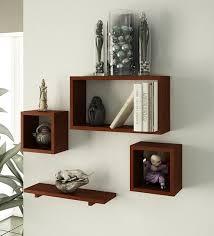 wall shelves pepperfry buy home sparkle set of 4 mango wood wall shelves online