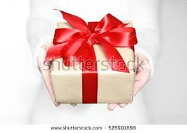 christmas gift bow holding giving christmas gift present stock photo 526901896
