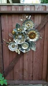 funky junky fence garden art made from old metal serving dishes