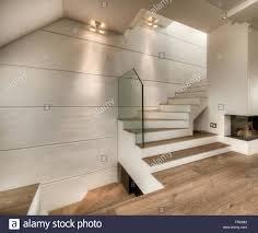 interior fireplace and stairs in white in modern apartment stock