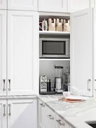 microwave shelf dark quartz with white cabinets stainless