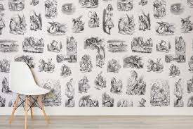 channel your inner bookworm with these enchanting wallpapers curbed fall down the rabbit hole with alice photos courtesy of murals wallpaper