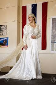 Wedding Flag Bride In 1940s Wedding Dress Posing In Front Of Flag During A