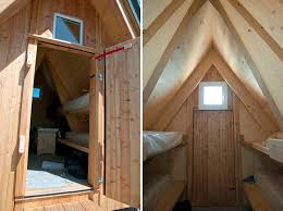 small a frame house wooden a frame cabin crowns alpine mountaintop