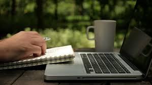 designer freelancer a freelancer designer looking ideas on laptop and writing on