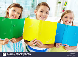 classmates books portrait of happy classmates with books smiling at in stock