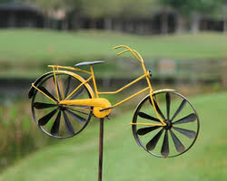 yellow bicycle spinner garden ornament