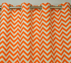 Noble Curtains Noble Grommet Top Chevron Orange Curtains Hanging On Stainless